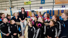 Raising the bar on gymnasts' expectations