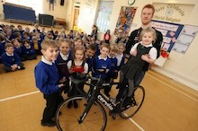 Ed gets on his bike to entertain youngsters at Shelley First School